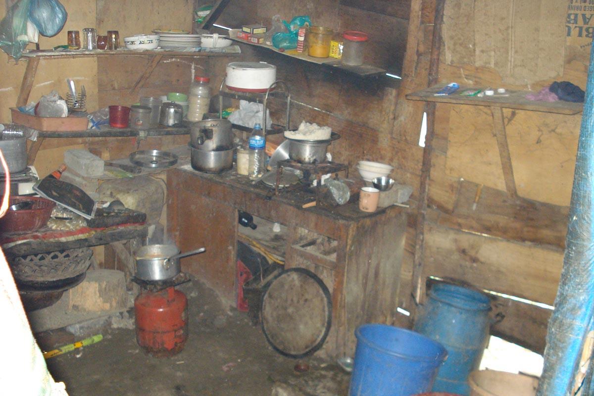 Inside Ama Jigmey's house in a Tibetan settlement in India. Photo Courtesy: Tibet Sun